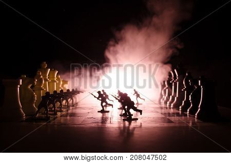 War Concept. Silhouettes Of Soldiers On Chessboard. War Concept. Military Silhouettes Fighting Scene