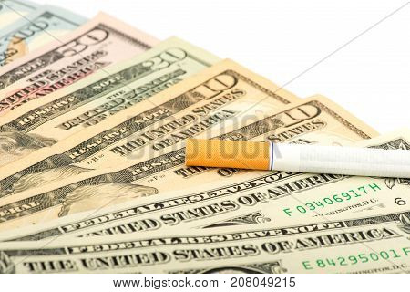 cigarette, a cigarette on dollars, a pack of cigarettes, a close-up of a cigarette, money