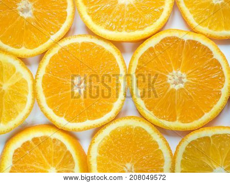 Abstract background with citrus-fruit of orange slices. Close-up