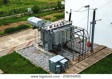 High voltage oil-filled power transformer on electrical substation