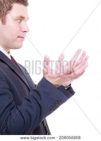 Man wearing tuxedo holding something in two hands looking at it empty copyspace and textspace.