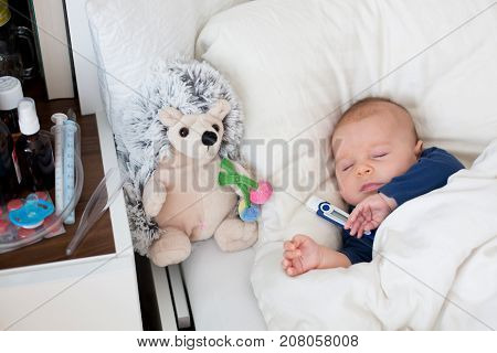 Cute Newborn Baby Boy, Lying In Bed With Cold