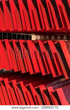 red monotone shelf trays in three floors as abstract patterning