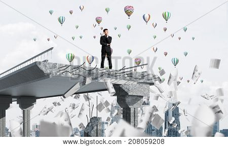Confident businessman in suit standing among flying papers on broken bridge with flying balloons on background. 3D rendering.