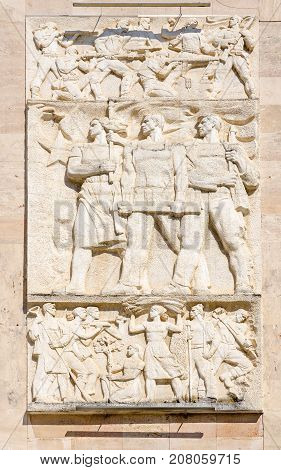TIRANA ALBANIA - SEPTEMBER 6 2017: Bas-relief on building of residence of Prime Minister (former Central Committee of Communist Party of Albania) Tirana Albania