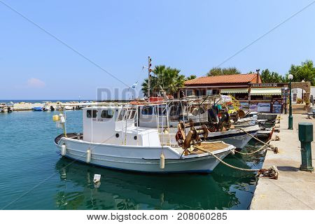 RHODES, GREECE - AUGUST 2017: Small sea port with moored fishing boats on Rhodes island, Greece