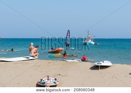 RHODES, GREECE - AUGUST 2017: Surfers at coast of Rhodes island in Prasonisi district, Greece