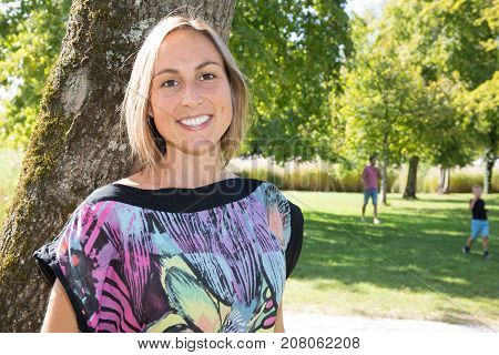 Portrait Of A Beautiful Smiling Woman Outside At The Park