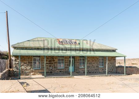 BARKLY WEST SOUTH AFRICA - JULY 7 2017: The toll house now a museum at the historic Barkly bridge over the Vaal River at Barkly West a town in the Northern Cape Province of South Africa