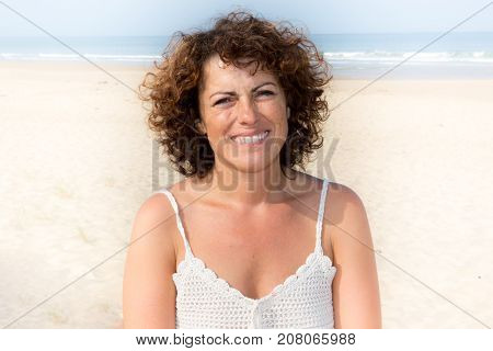 Happy Woman On The Beach. Portrait Of The Beautiful Girl Close-up, The Wind Fluttering Hair. Spring.