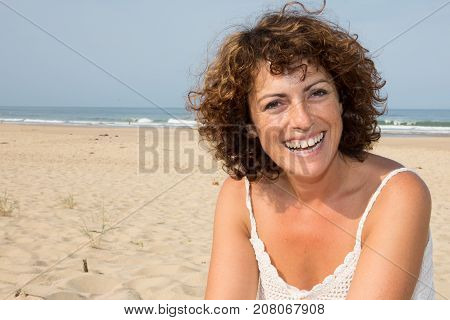 Close Up Lifestyle Portrait Of Happy Laughing Woman On Beach True Emotions.