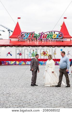 Newlyweds On A Walk On Red Square.