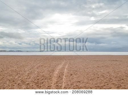 Clean sand beach with path to the ocean