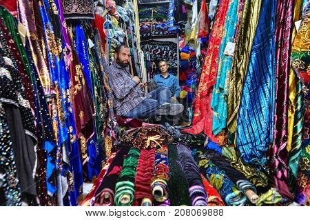 Fars Province Shiraz Iran - 19 april 2017: Two sellers of Iranian fabrics are sitting in a textile shop in the city bazaar.