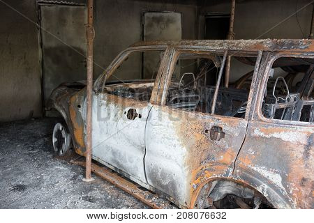 Body Of The Burnt Car In The Street Garage