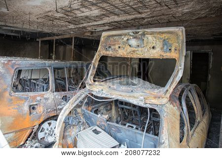 Burned Out Passenger Car After An Electrical Fire In Residential Area