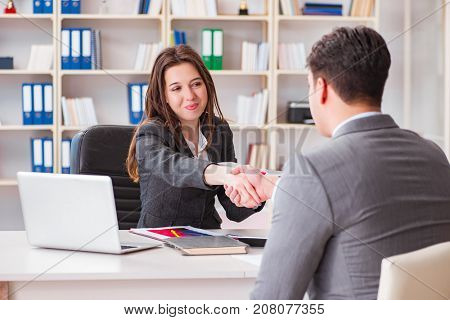 Business meeting between businessman and businesswoman