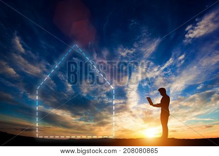 Man working on a laptop next to a house symbol. Smart home concept, maintaining a household. 3d illustration.
