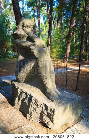 PITSUNDA ABKHAZIA SEPTEMBER 16 2017: Stone sculpture of a sitting girl in Pitsunda