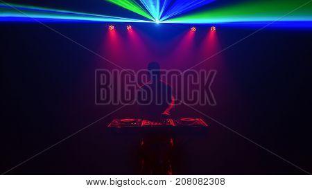Male Disc Jockey, Dj, Silhouette With Laser Light