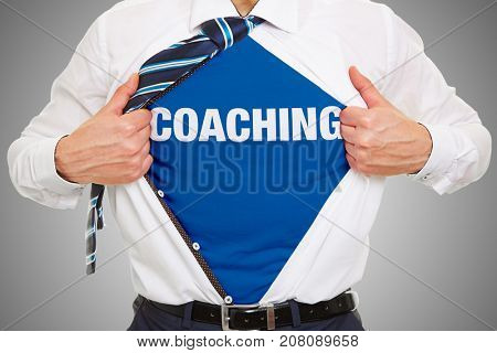 Man as business consultant with coaching  word on shirt as training concept