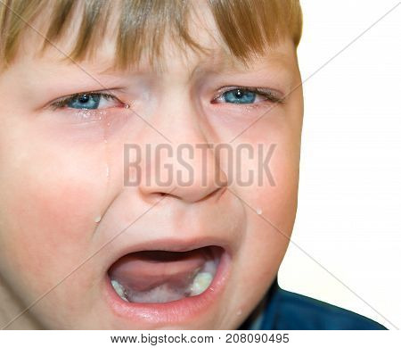 little boy was crying from hurt tears stream down cheeks. emotion child sadness. kid cry isolated on white background