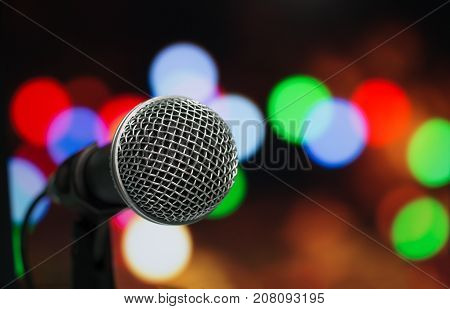 Microphone on abstract blurred of speech in seminar room or speaking conference hall Event bokeh light Background