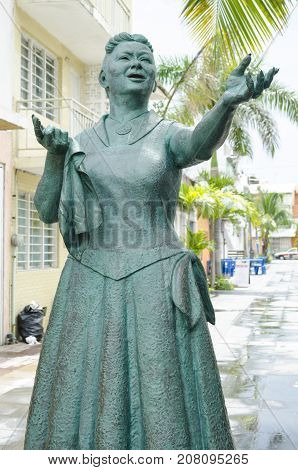 VERACRUZ, MEXICO- SEPTEMBER 27, 2017: Toña la Negra statue at Callejón Toña la Negra at famous neighborhood La Huaca in Veracruz, Mexico. Toña la Negra was an actress and singer, known for her interpretation of boleros and songs written by Agustín Lara