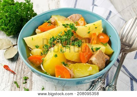 Meat stew with potatoes and carrots. Tasty and nourishing lunch