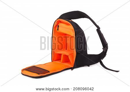 Outdoor backpack for camera isolated on white background. Outside is black, inside is orange. Close-up.