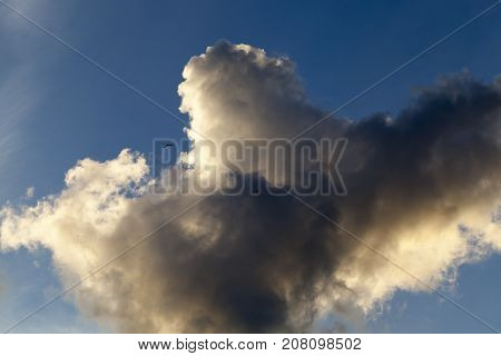 cumulus clouds that are in the blue sky. Picture with a shallow depth of field