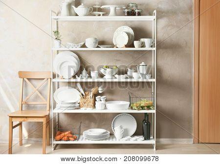 Storage stand with white kitchenware indoors