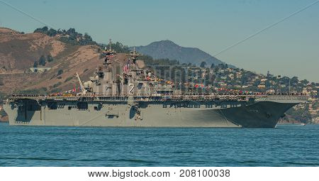 USS Essex LHD-2 Carrier in San Francisco Bay for Fleet Week Oct 6, 2017 with Military Personnel standing at Attention on Deck