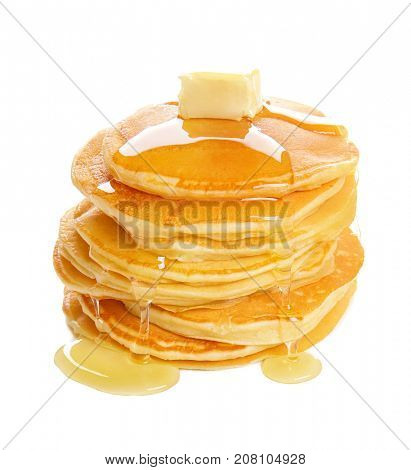 Tasty pancakes with honey and piece of butter on white background
