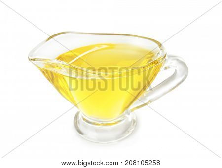 Gravy boat with cooking oil on white background