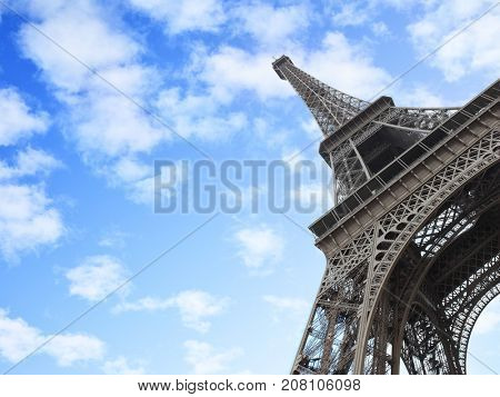 The Eiffel Tower in Paris, France. Copyspce composition, angle shot