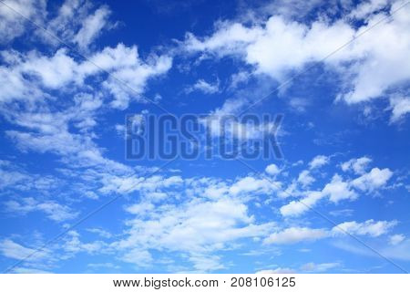 Dark blue sky with clouds, may be used as background