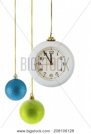 Christmas balls and clock isolated over the white background