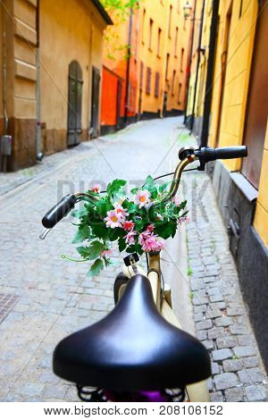 Bicycle with bunch of flowers on handle bar in Stockholm, Sweden