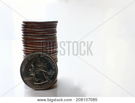 US Dollar coins, white background as well-being in business