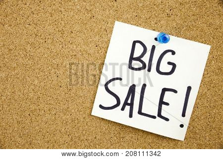 A Yellow Sticky Note Writing, Caption, Inscription Phrase Big Sale In Black Ext On A Sticky Note Pin