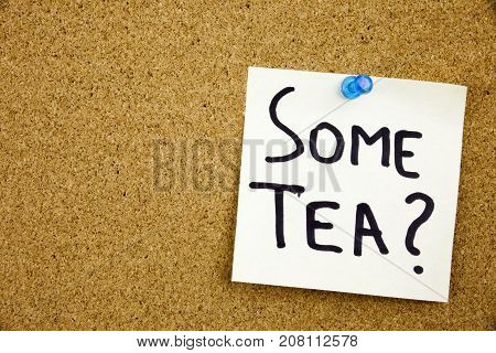A Yellow Sticky Note Writing, Caption, Inscription Phrase Some Tea In Black Ext On A Sticky Note Pin