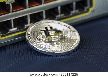Mint bitcoin with ethernet ports on the background