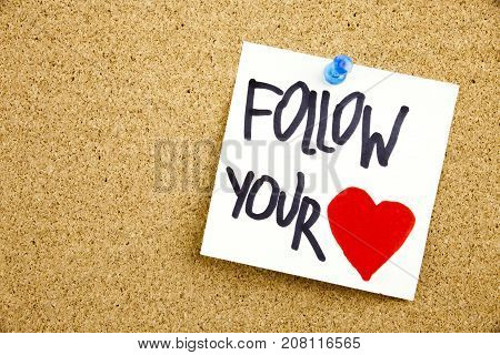 A Yellow Sticky Note Writing, Caption, Inscription Phrase Follow Your Heart In Black Ext On A Sticky