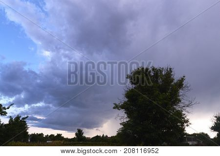 Evening storm clouds over the village landscape