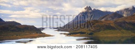 Strait from fjord to sea between rocks in the Lofoten islands. Norwegian panoramic landscape.