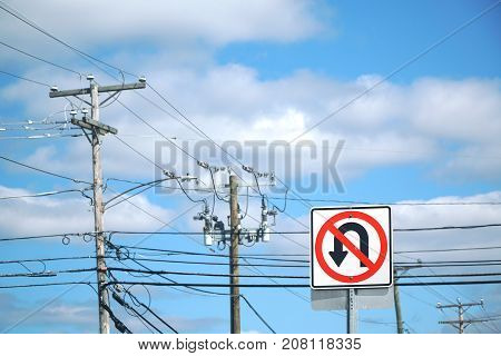 no U turn traffic sign in front of power poles