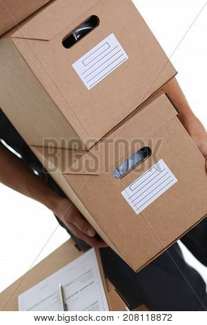 Specialist courier delivery service carries boxes with parcels things of customers working as a loader delivers everything to the specified addresses, ready to fulfill any order at a specified time