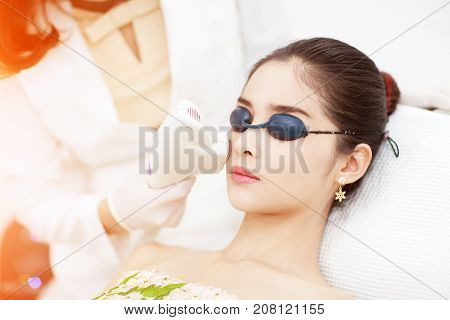 Face Care. Facial Laser Hair Removal. Beautician Giving Laser Epilation Treatment To Young Woman's F
