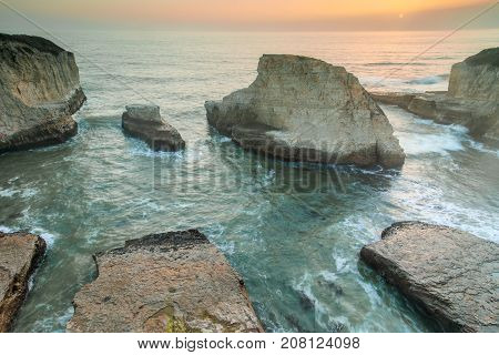 Fall Sunset over Shark Fin Cove (Shark Tooth Beach). Davenport, Santa Cruz County, California, USA.
